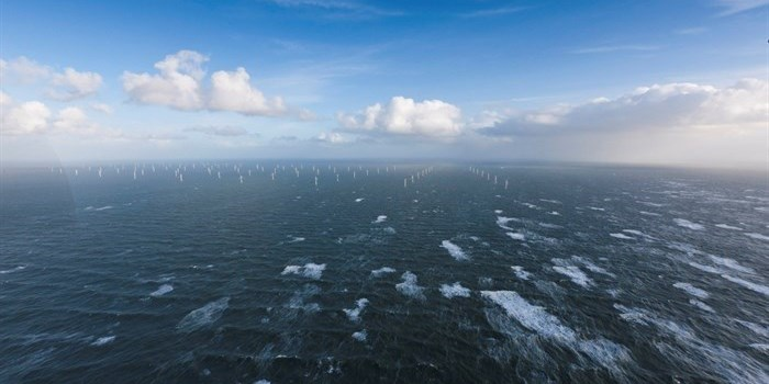A offshore wind farm with many wind turbines